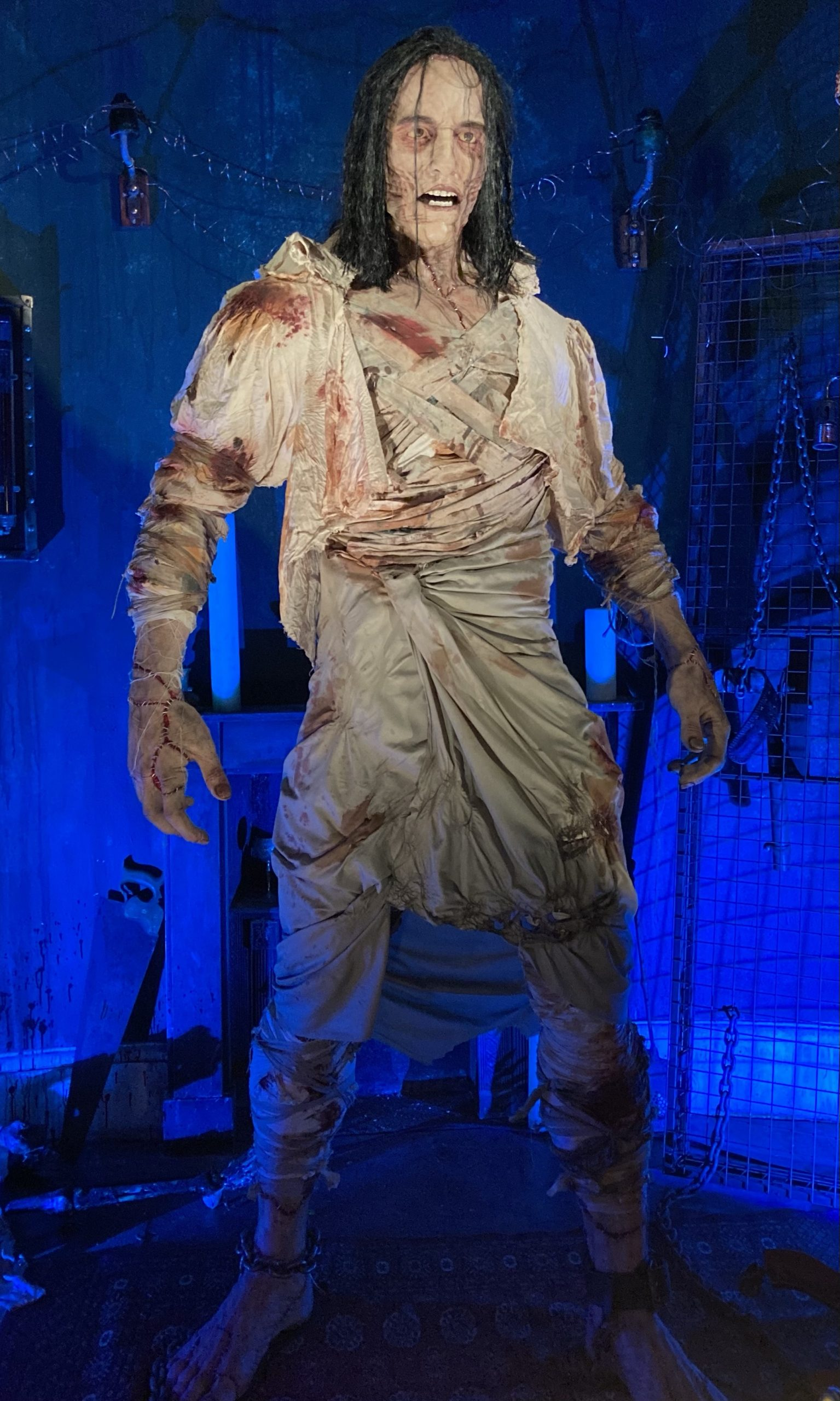 A photo of a life-size animatronic of Frankenstein's Monster.